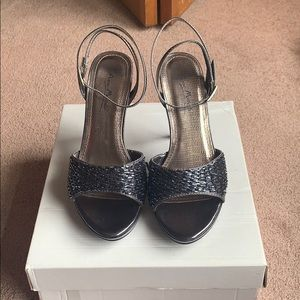 Pewter gray heels. Wrap around ankle.